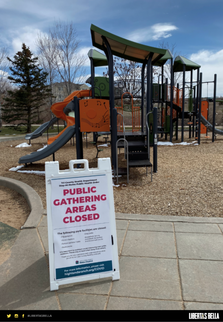 "COVID-19 lockdowns - deserted playground with a sign that says ""public gathering areas closed"""
