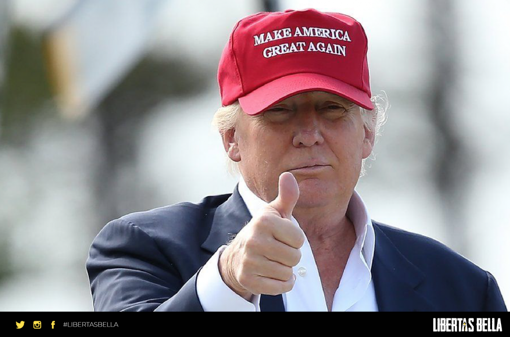 "Libertarian vs Republican - Donald Trump in red ""Make America Great Again"" red cap giving a thumbs up to the camera"
