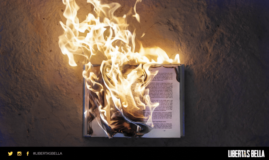 censorship quotes - book on concrete floor engulfed in flames.
