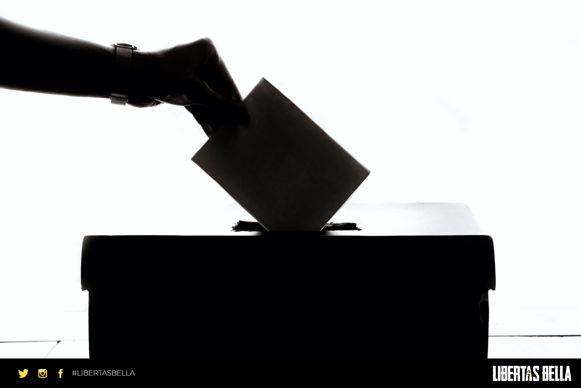 democracy quotes - grayscale hand placing a vote in a ballot box